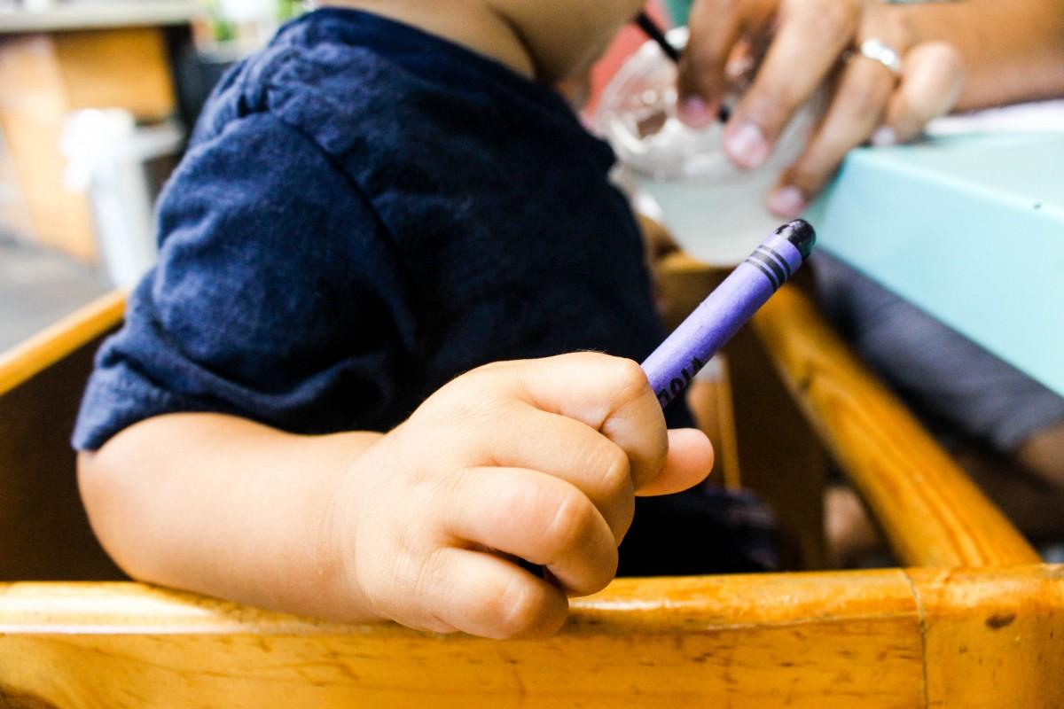Rish holding crayon