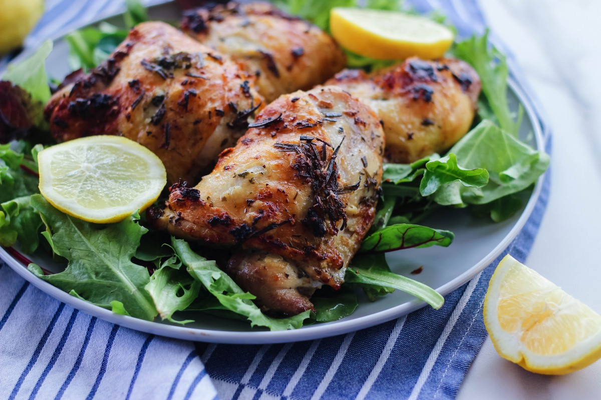 roasted lemon and herb chicken thighs, bone in chicken thighs, love alfa chicken, how to cook bone in chicken thighs, oven roasted bone in chicken thighs, oven chicken thighs, roasted chicken recipes, summer chicken recipes, chicken thigh summer recipes